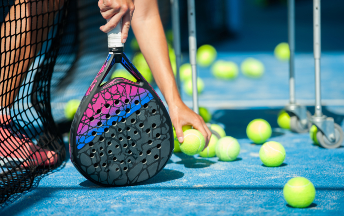 close-up of balls and paddle racket